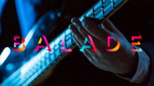 Le logo de la série Balade devant l'image d'une main à la guitare.